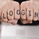 The word blogging written in ink on a pair of side-by-sirde hands, one word per finger.
